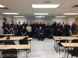 Member of Concordville Fire Company honoring Bill Cloud on his 70th year of active status with Concordville.
