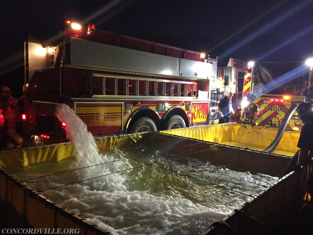 Engine 3-5 putting in water with Engine 41 drafting to supply the drill