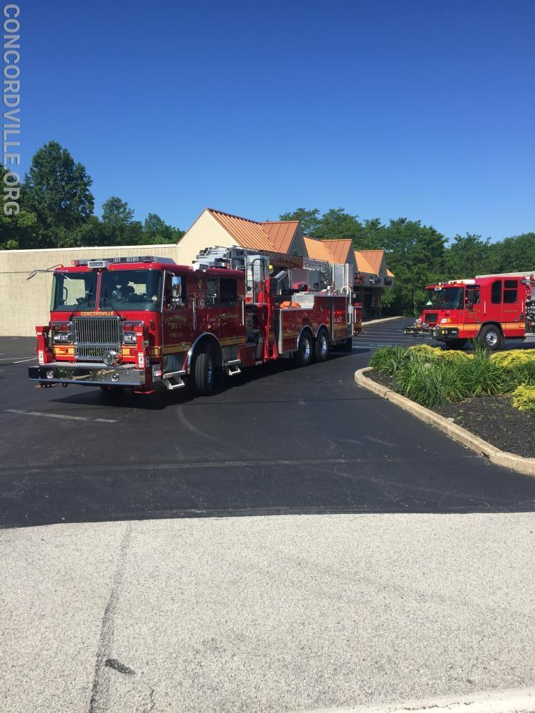 Tower Ladder 59 and Engine 593 pulling out at the 1st parade